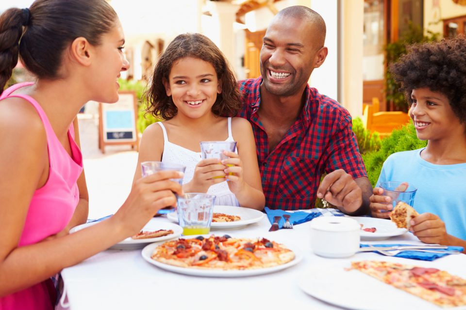 Family eating a meal at a outdoor restaurants