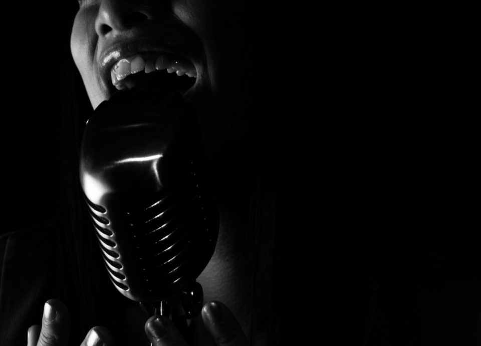 Close up of Singer singing into a microphone