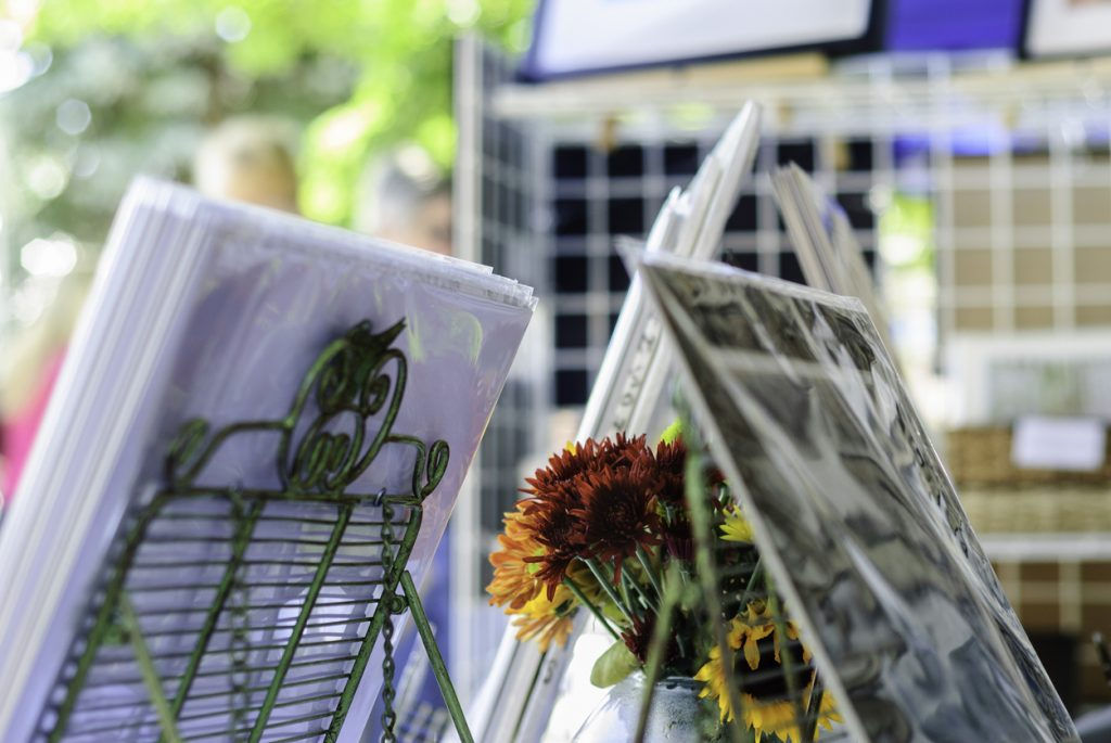 Flowers and photographs at art events
