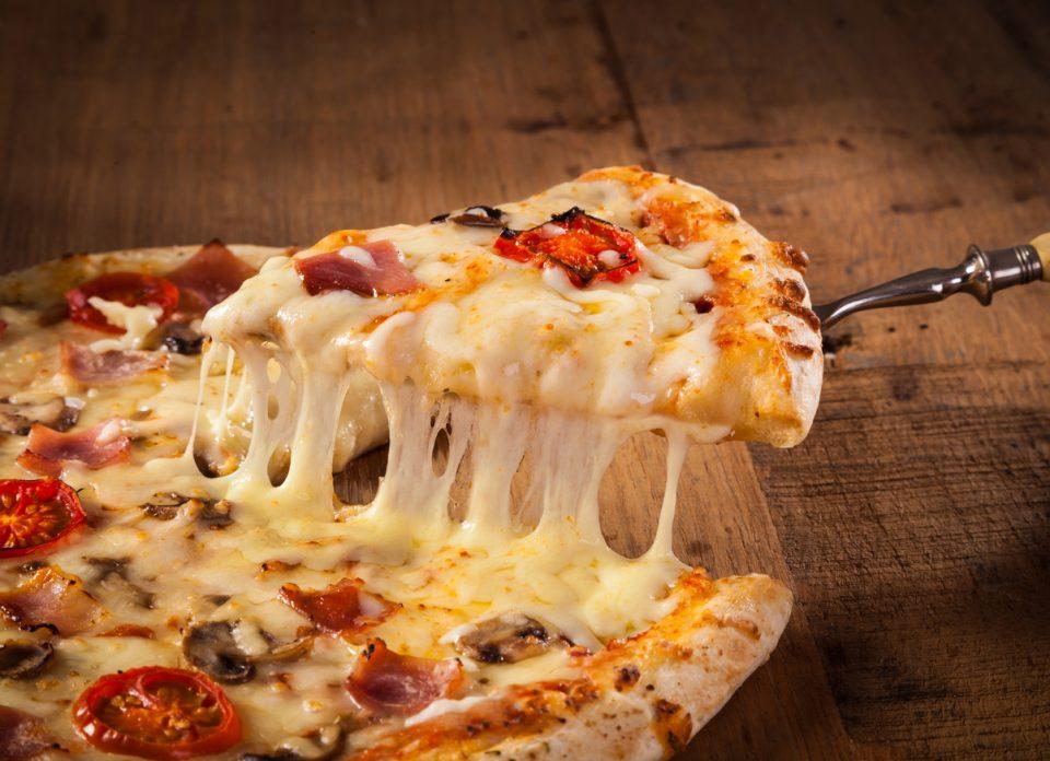 Slice of hot pizza at restaurants