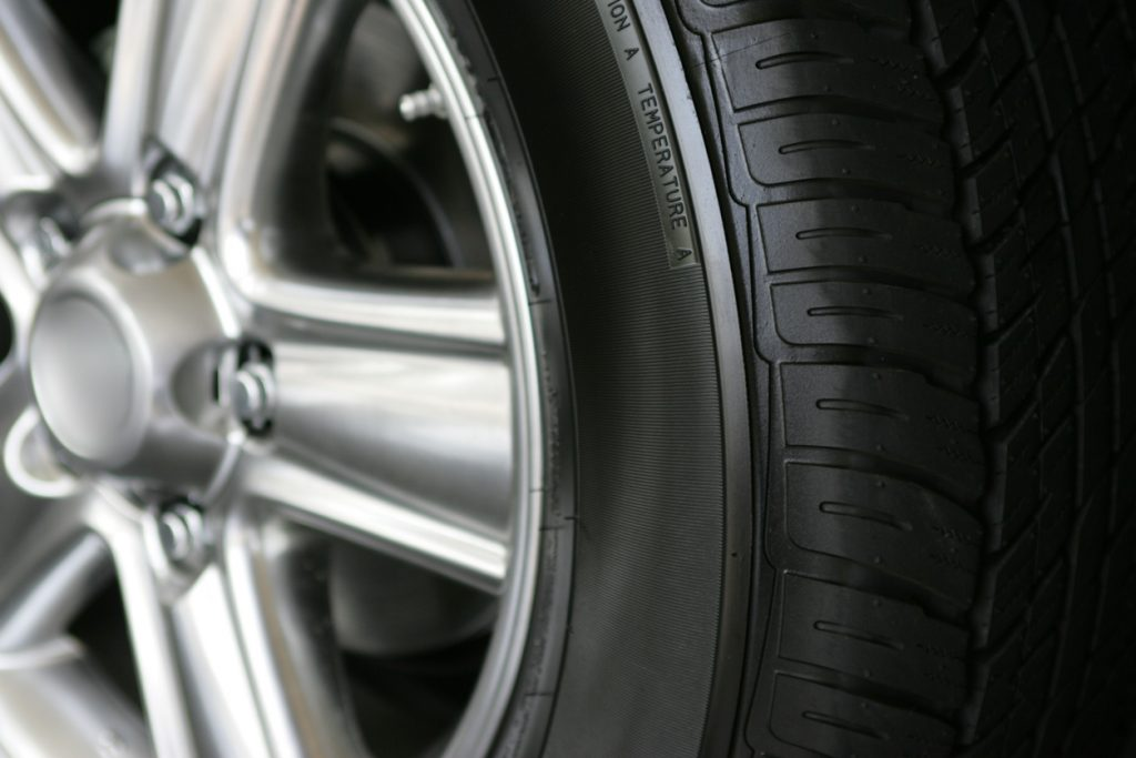 Closeup of a wheel on a new SUV at a local car dealer.