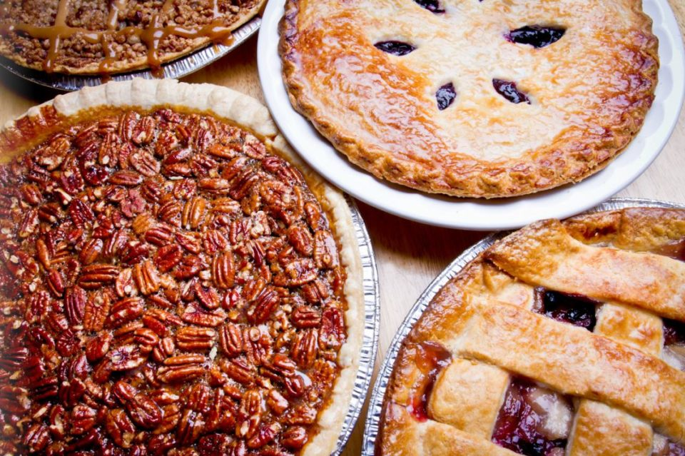 Apple caramel, apple berry, pecan and blueberry pies