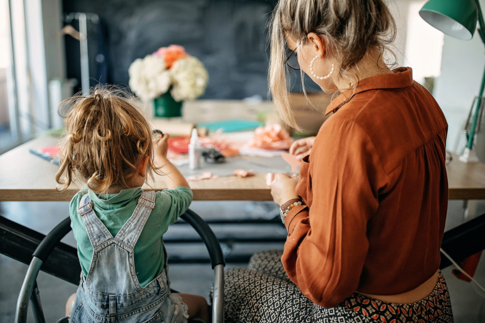 Mother and daughter making flower crafts